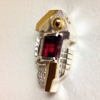 Custom pendant with garnet in silver and gold
