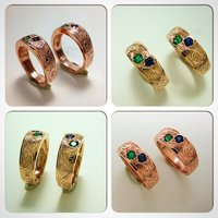 Wedding set in red gold with emerald and sapphire