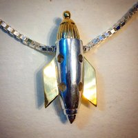 Rocket pendant in 18K yellow gold and sterling