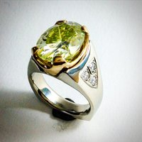 RING WITH 6.7 CARAT IN WHITE AND YELLOW GOLD