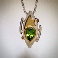 PERIDOT PENDANT IN MULTIPLE METALS WITH DIAMONDS