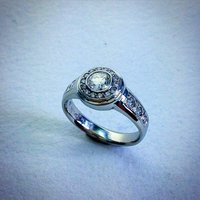 LADIES RING WITH DIAMONDS IN 18K WHITE GOLD