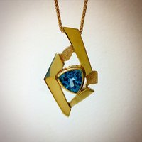 BLUE TOPAZ IN 18K YELLOW GOLD